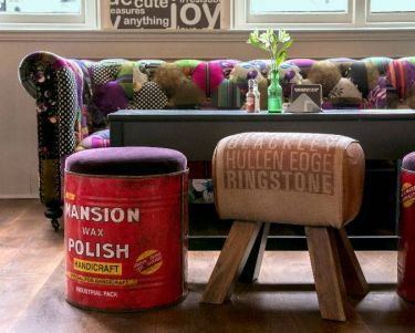sofa and stools made from vintage containers