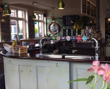 Front view of bar with flowers and Tbar