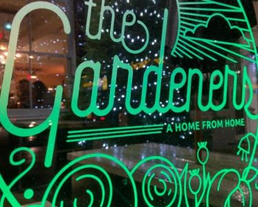 Green Garden logo with Xmas tree behind
